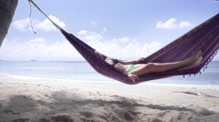 Sexy woman relaxing beach hammock Stock Footage