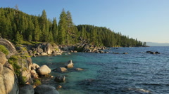 Lake Tahoe east shore at sunset (pan) Arkistovideo