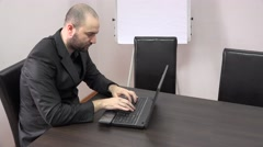 Manager at the office receive bad news on laptop email, lose money, anxious, 4K Stock Footage