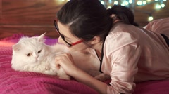 A woman is petting a cat Stock Footage