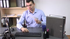 Employee at the office on a very hot day, not working waving paper to cool down  - stock footage