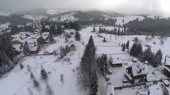 Aerial shot of village in the Carpathian mountains at winter time Stock Footage