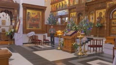 Splendid Christian Iconostasis With a Bearded Man Before It, Who Looks at Fir Stock Footage