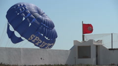 Waving Red Flag Of Tunisia Over Parachute Stock Footage