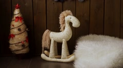 Vintage wall and wooden toy horse - stock footage