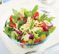 Mixed vegetable salad sprinkled with grated cheese Stock Photos