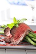 Slices of roast beef and string beans Stock Photos