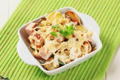 Pork and potato casserole topped with cheese - stock photo