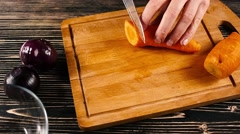 Close up of a chef carefully cutting some carrots - stock footage