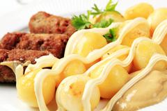 Cevapcici with potatoes, mayonnaise and mustard - stock photo