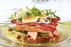 Traditional turkey and bacon club sandwich without the top slice - stock photo