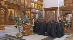 A Lot of Priests Praying Before an Old Iconostasis of Orthodox Cathedral, Which Stock Footage