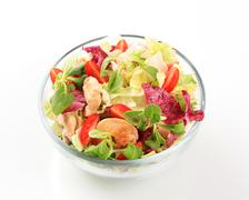 Bowl of greens with pieces of chicken meat Stock Photos