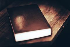 Mysterious Book with No Title on Wooden Table. - stock photo
