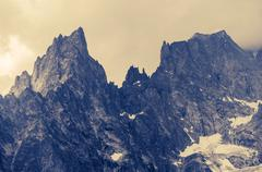 Cloudy Alp Mountains Scenery. Granite Alp Peaks. - stock photo