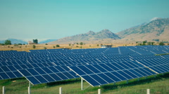 Solar power plant clean energy countryside scenery mountain sky sunny day dolly Stock Footage