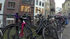 Dolly shot of parked bicycles typical dutch canal houses in Utrecht Holland 4k Stock Footage