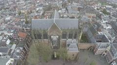 Aerial view of Utrecht city camera facing east showing Dom Church tilting up 4k Stock Footage