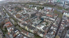 Aerial bird-eye view of Utrecht canal houses and boat moving over canals 4k Stock Footage