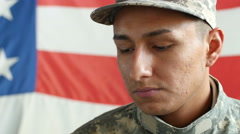 Portrait of a young soldier, eyes looking down and then upward Stock Footage