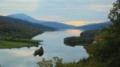 Lake Scotland pan sunset Stock Footage