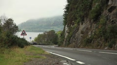 Loch Ness lake and road Scotland Stock Footage