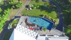 Aerial view of couple in private home swimming-pool Stock Footage