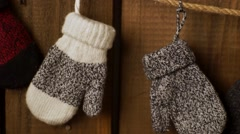 Children's mittens on rope - stock footage