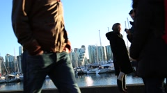 Dating, young couple taking selfies, water front Stock Footage