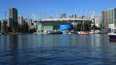 Vancouver, BC Place stadium, small ship sailing Stock Footage