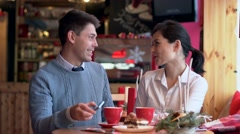 Two people in cafe taking a selfie Stock Footage