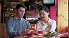 Two people in cafe enjoying each other Stock Footage