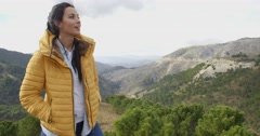 Smiling woman appreciating the peace of nature Stock Footage