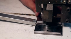 Man sawing piece of steel in bandsaw Stock Footage