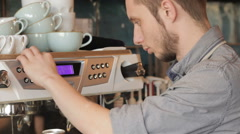 Stock Video Footage of Barista makes coffee with a coffe machine