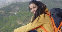 Happy vivacious young woman backpacker Stock Footage