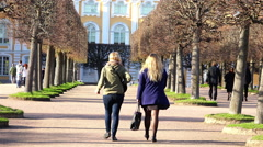 people walk along the Avenue of considering the architecture of buildings - stock footage