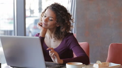 Young business woman sitting in cafe Stock Footage