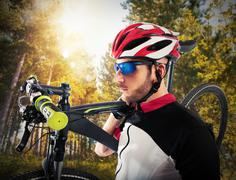 Cyclist and his mountain bike Stock Photos