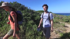 Couple on a trekking day in Caribbean island - stock footage