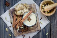 Masala chai with spices. Cinnamon stick, cardamom, ginger, clove, star anise, - stock photo