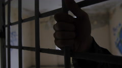 Hands detail in an old jail Stock Footage