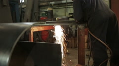 Man using a metal cutting torch in a metal fabricating workshop - stock footage