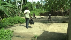 PAKRO YOUNG MAN ARRIVES AT BOREHOLE Stock Footage