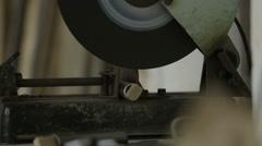 Main in workshop using a metal chop saw cutting steel tubing Stock Footage