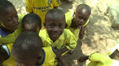 PAKRO SCHOOL CHILDREN IN YELLOW SMILE INTO CAMERA Stock Footage