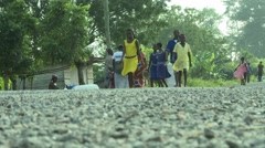 PAKRO SCHOOL CHILDREN WALK ON STREET Stock Footage