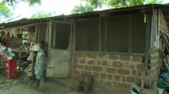 PREGNANT WOMAN COMES OUT OF PAKRO HOME - stock footage