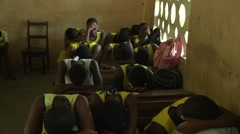 PAKRO STUDENTS PRAY IN A CLASSROOM Stock Footage