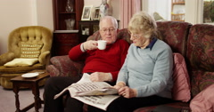 Portrait of an old man drinking coffee while sitting with her wife Stock Footage